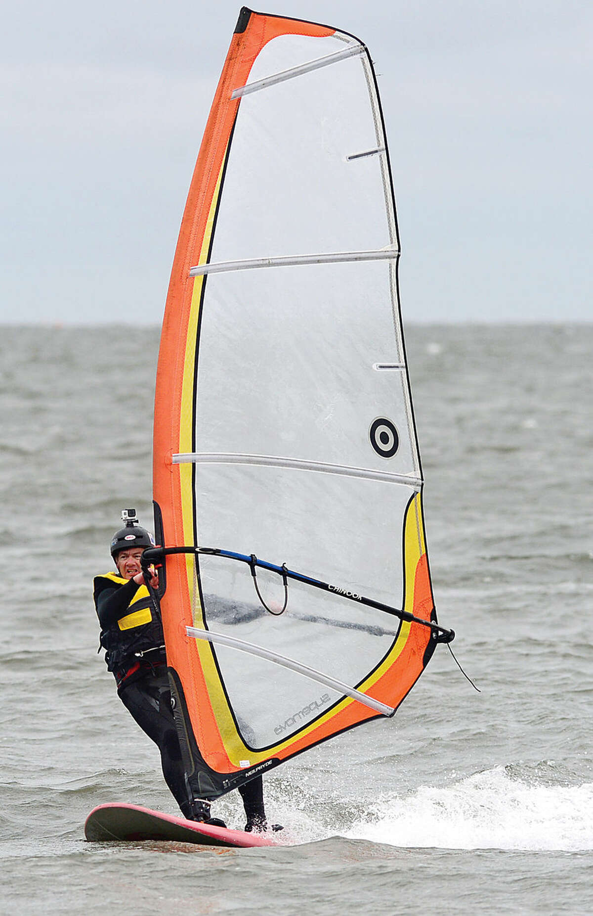 Hour photo / Erik Trautmann Board enthusiasts including Ross Colbert take advantage of the windy conditions at Calf Pasture Beach Saturday to windsurf and kiteboard.