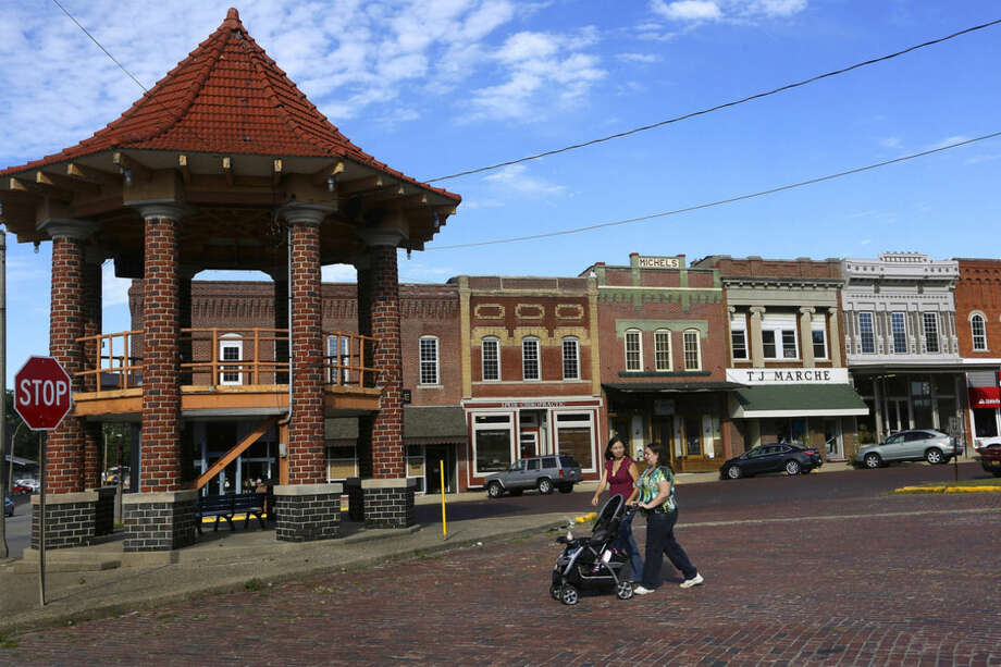 In this Tuesday, Sept. 15, 2015 photo, shops on the town square open for business in Albion, Ill. In Albion, stores can't sell package liquor, but marijuana has been welcomed as a badly needed source of jobs. (AP Photo/Seth Perlman)