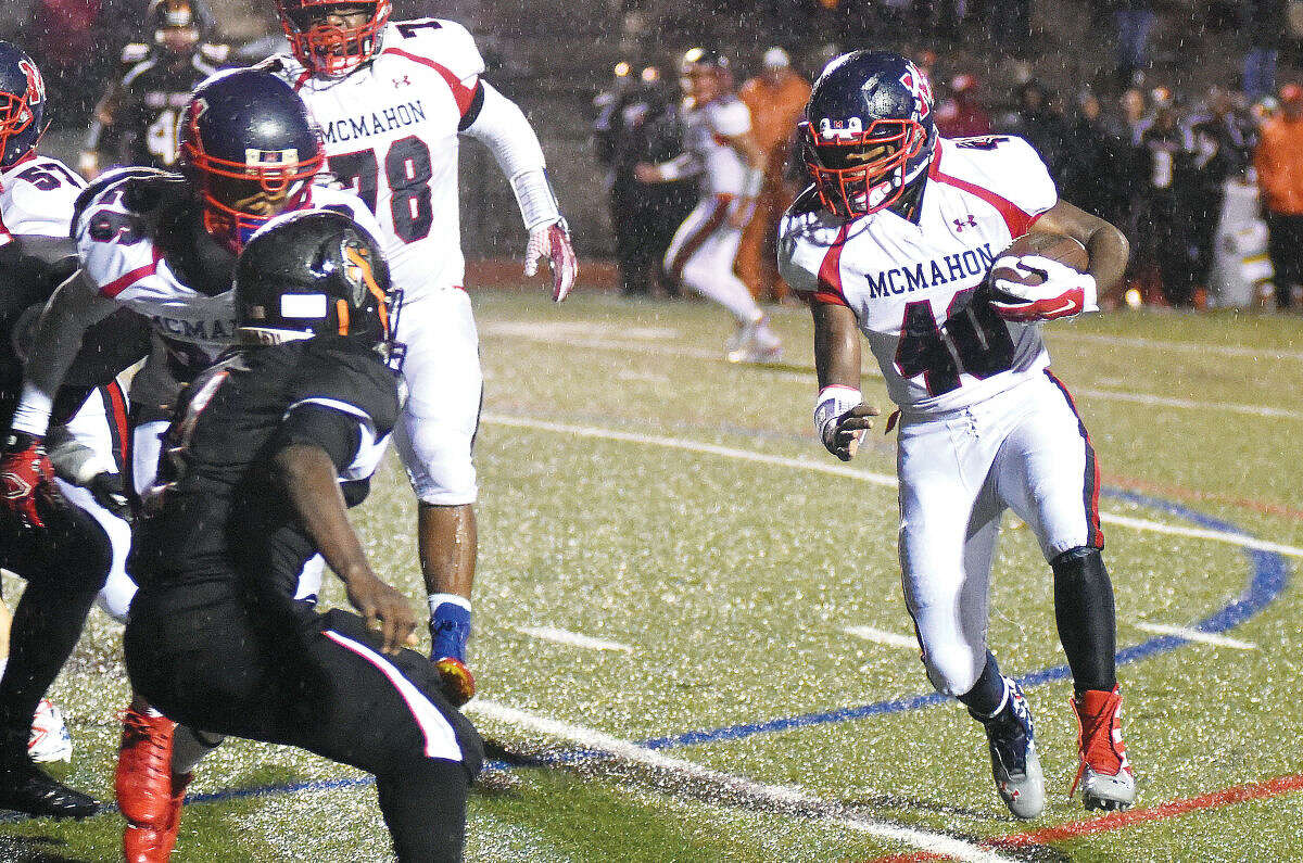 Hour photo/John Nash - Jared Fields (40) of Brien McMahon looks for a hole while running for a gain in the first half of Friday's FCIAC football against Stamford at Boyle Stadium.