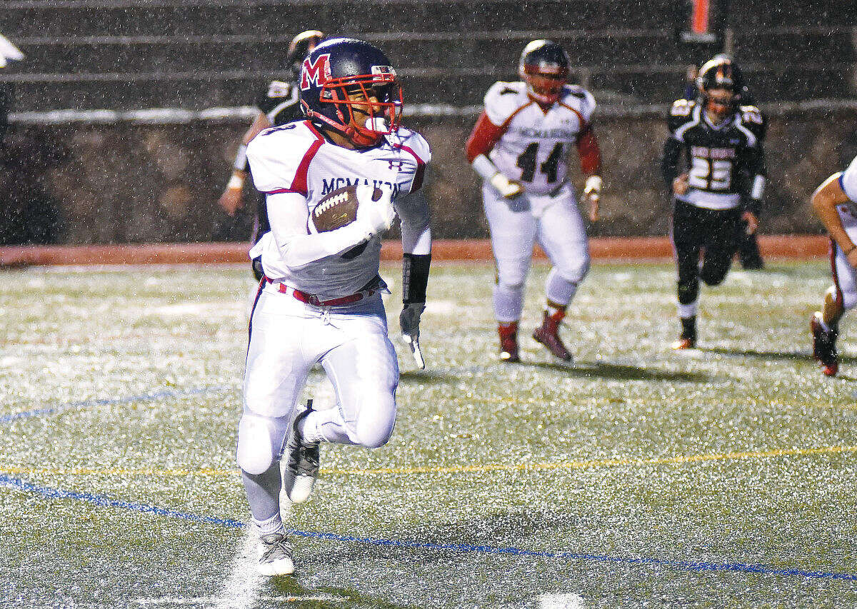 Brien McMahon running back Amari Brown dodges the rain drops while toting the ball up field during Friday's FCIACfootball encounter against Stamford at Boyle Stadium. The Senators were defeated by the host Black Knights 26-22. (Hour photo/John Nash)