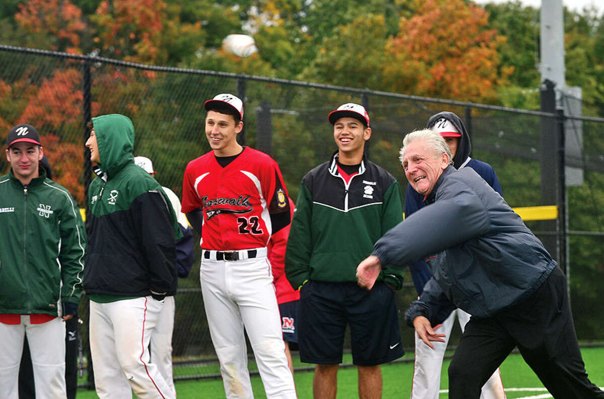 Hour photo / Erik Trautmann Norwalk mayor Harry Rilling throws out the ceremonial first pitch during the grand opening of new Athletic Complex at Nathan Hale Middle School Saturday.