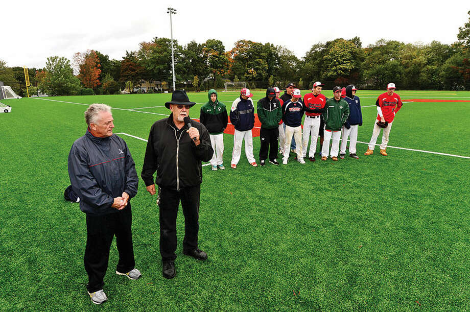 Hour photo / Erik Trautmann Councilman Jerry Petrini speaks during the grand opening ceremony of new Athletic Complex at Nathan Hale Middle School as Norwalk mayor Harry Rilling and members ogf the America Legion bvaseball team look on Saturday.