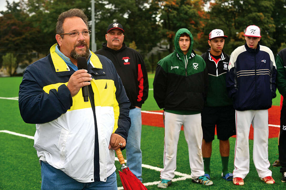 Hour photo / Erik Trautmann Michael Mocciae, Director, Norwalk Recreation & Parks Department, speaks during the grand opening ceremony of new Athletic Complex at Nathan Hale Middle School Saturday.