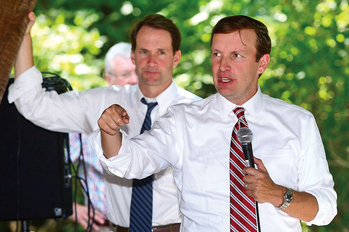 Hour photo / Erik Trautmann US Senator, Chris Murphy, and US Congressman Jim Himes, speak to the Wilton Kiwanis Club with an update on foreign relations at the Wilton Family YMCA Wednesday.