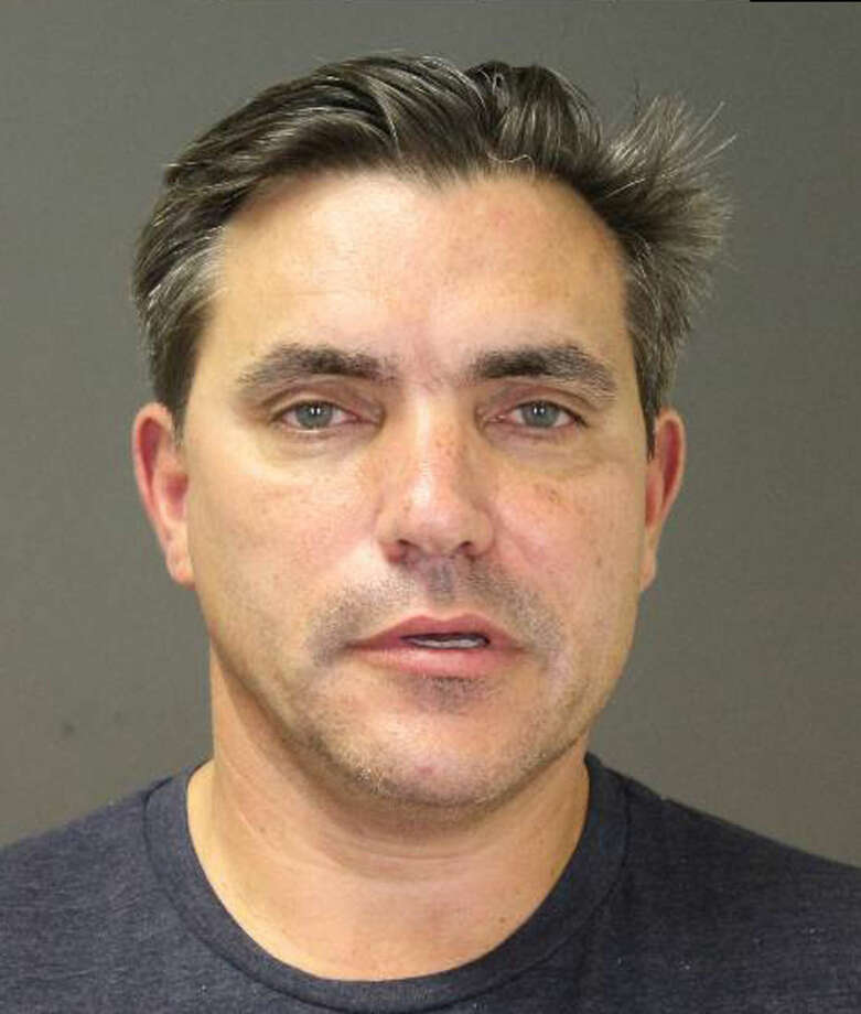 "This photo provided by the Southampton Town Police Department on Long Island shows celebrity chef Todd English, 45, after his arrest early Sunday morning, Aug 31, 2014 in Southampton, N.Y., where he was charged with driving while intoxicated. English has opened a number of restaurants around the country, including Olives, Figs, and Fish Club. He's also been a regular on television programs including ""Iron Chef USA."" Authorities say he posted $1,500 bail at Southampton Town Justice Court. (AP Photo/Southampton Town Police Department)"