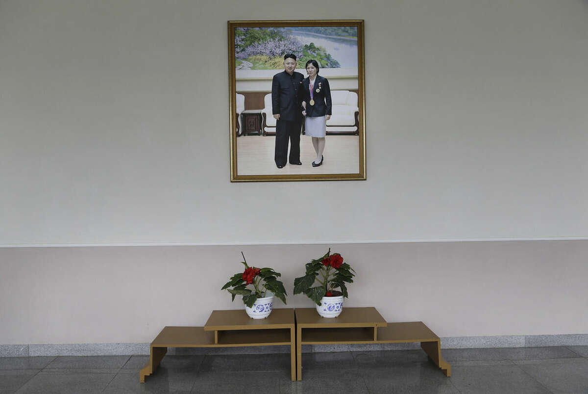 A portrait of North Korean leader Kim Jung Un posing with a North Korean gold medalist in Judo, An Kum Ae, decorates the walls of a local gymnasium, Tuesday, Sept. 2, 2014 in Pyongyang, North Korea. In just over a week, North Korea will send its top athletes to win gold for their leader in what could well be the biggest sporting event of their lives and a major propaganda campaign for their nation, the Asian Games in Incheon, South Korea.(AP Photo/Wong Maye-E)