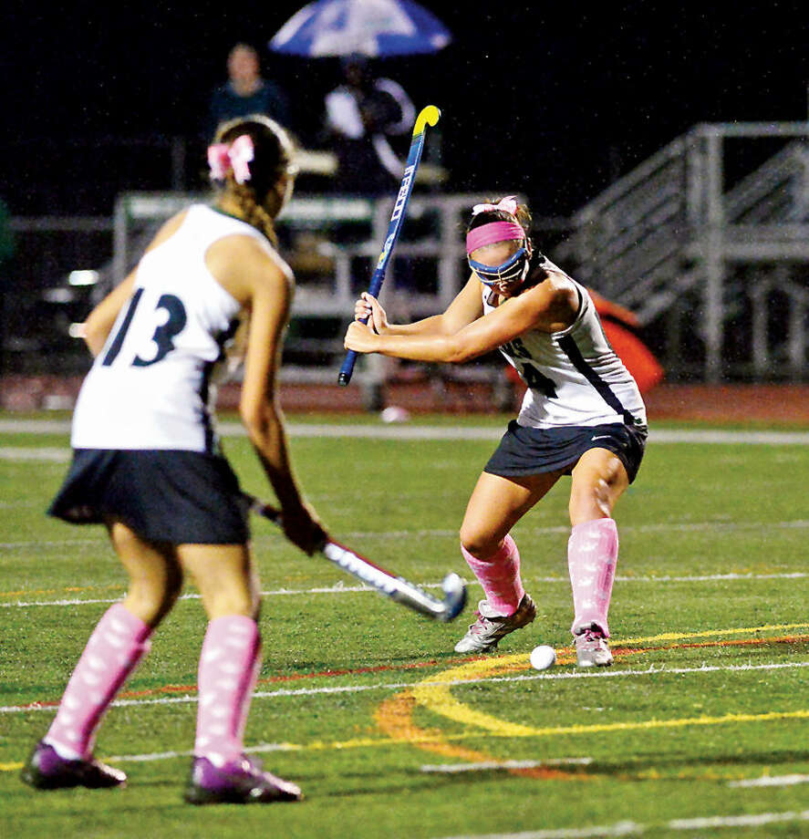 Hour photo / Erik Trautmann The Norwalk High School Field Hockey team takes on Staples High School at Norwalk Thursday evening.