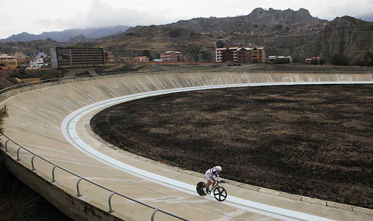 French cyclist Claude Bares, rides on his bicycle at the Alto Irpavi velodrome in La Paz, Bolivia, Sunday, Aug. 31, 2014. Bares, 75, raced 36 kms., 402 mts, and 55 cms. in an hour, trying to break his own world record in the 75-80 years category that he set last April in France. This time, riding in the La Paz velodrome located 3, 340 meters above sea level, Bares was unable to beat his own record. (AP Photo/Juan Karita)