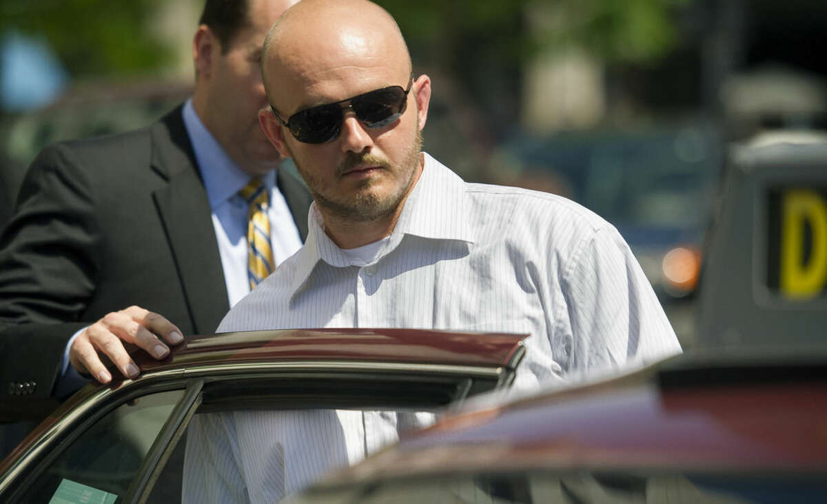 FILE - In this June 11, 2014, file photo, former Blackwater Worldwide guard Nicholas Slatten enters a taxi cab as he leaves federal court in Washington, after the start of his trial. After 10 weeks of argument and testimony, the case goes to the jury on Tuesday, Sept. 2, 2014. (AP Photo/Cliff Owen, File)