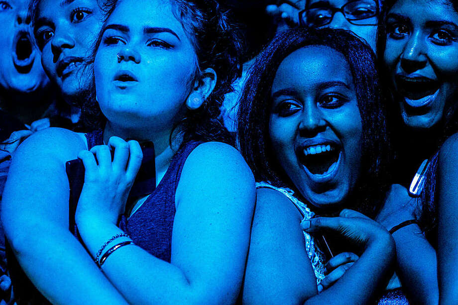 Fans listen to Foster The People on the third and final day of Bumbershoot, Seattle's annual music and arts festival, Monday, Sept. 1, 2014, in Seattle. (AP Photo/seattlepi.com, Jordan Stead) MAGS OUT; NO SALES; SEATTLE TIMES OUT; TV OUT; MANDATORY CREDIT