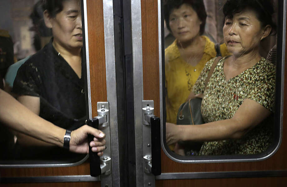 North Korean commuters wait to board a subway car at a station, Monday, Sept. 1, 2014 in Pyongyang, North Korea. Foreign visitors are usually only allowed to take one to two stops, on Pyongyang's north-south Chollima subway line. (AP Photo/Wong Maye-E)