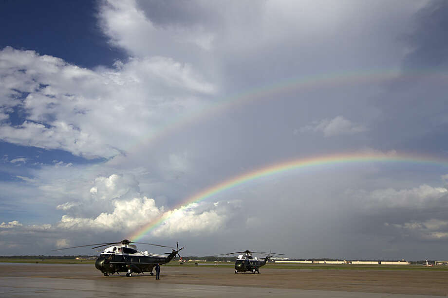 A rainbow appears over Marine One minutes before President Barack Obama landing at Andrews Air Force Base, Md., Monday, Sept. 1, 2014. (AP Photo/Jose Luis Magana)