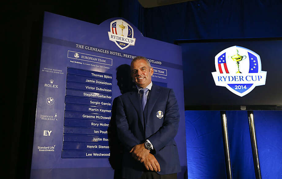 European Ryder cup team captain Paul McGinley stands by a list of his chosen players during a press conference at Wentworth Golf Club to announce his three wild card selections for his team to play at Gleneagles in Scotland against the USA, in Wentworth England, Tuesday, Sept. 2, 2014. (AP Photo/Kirsty Wigglesworth)