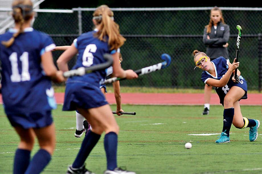 Hour photo / Erik Trautmann Wilton High School Girls Field Hockey team takes on Darien Thursday in Darien.