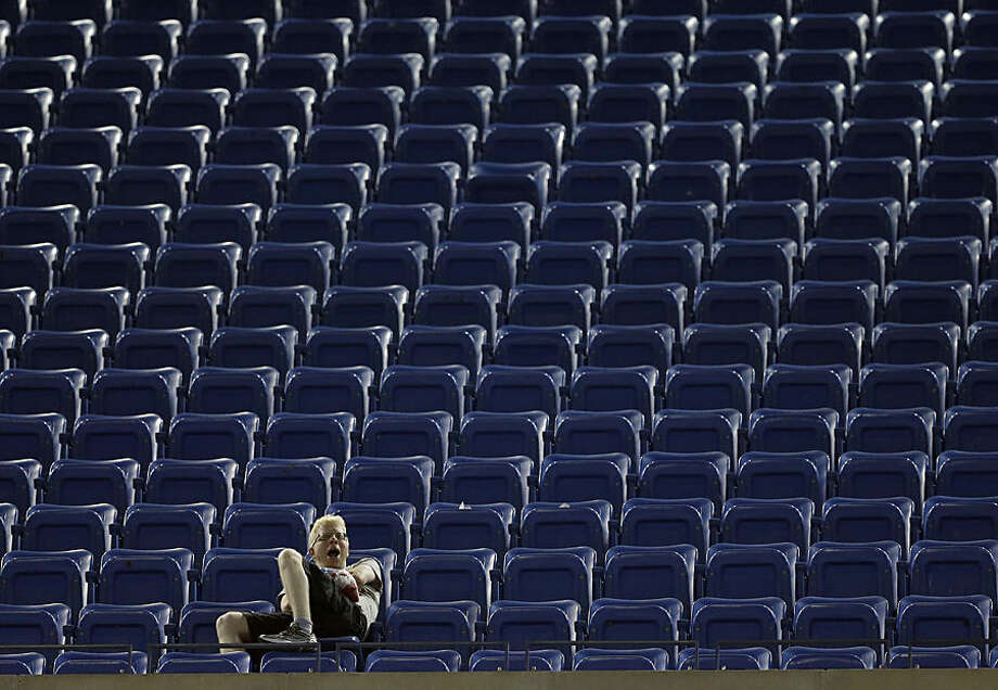 A fan yawns as he watches the match between Kei Nishikori, of Japan, and Milos Raonic, of Canada, during the fourth round of the 2014 U.S. Open tennis tournament Tuesday, Sept. 2, 2014, in New York. (AP Photo/Darron Cummings)