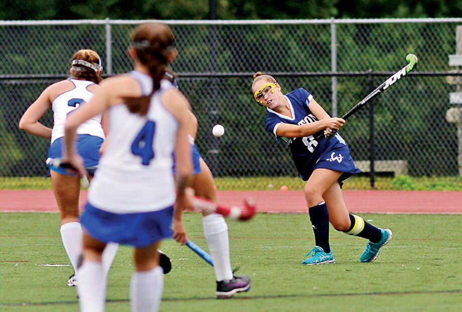Hour photo / Erik Trautmann Wilton High School Girls Field Hockey team takes on Darien Thursday in Darien.