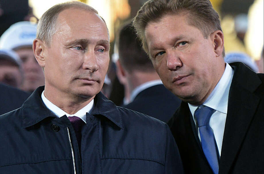 """Russian President Vladimir Putin, left, listens to Alexei Miller, CEO of Russian natural gas giant Gazprom during the ceremony marking the construction of gas pipeline """"Power of Siberia"""" connecting Russia and China near the village of Us Khatyn in Yakutsk region, Russia, Monday, Sept. 1, 2014. (AP Photo/RIA Novosti, Alexei Nikolsky, Presidential Press Service)"""