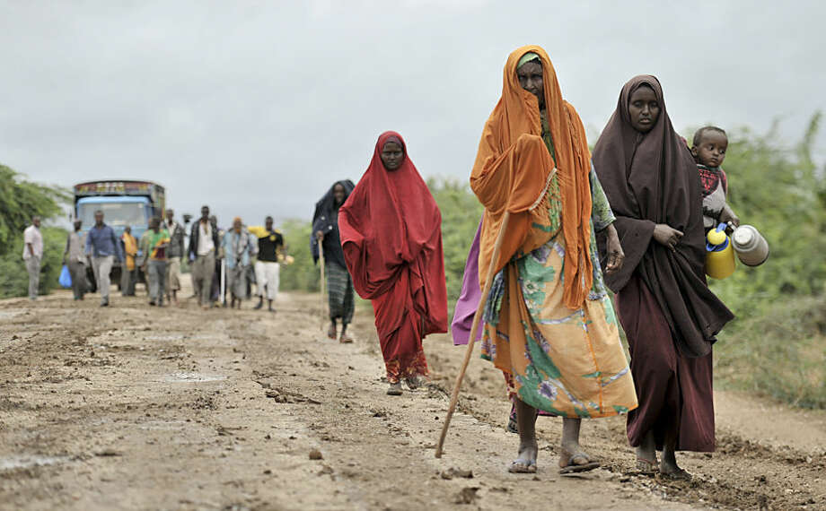 "In this photo taken Sunday, Aug. 31, 2014 and provided by the African Union Mission to Somalia (AMISOM) Monday, Sept. 1, 2014, civilians who had left the town of Bulomarer when it was held by al-Shabab militants, return following the town's capture by African Union (AU) and Somali government soldiers, in the Lower Shabelle region of Somalia. Somali government and AU troops have been engaging al-Shabab militants as part of their military offensive dubbed ""Indian Ocean"" aiming to oust al-Shabab from its last major hideouts in the southern parts of the Horn of Africa nation. (AP Photo/AMISOM, Tobin Jones)"
