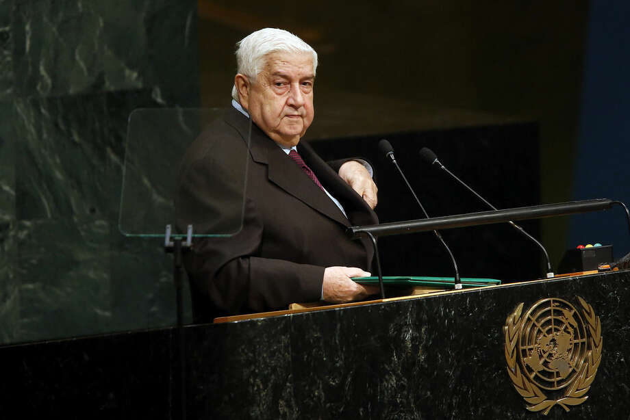 Syria's Foreign Minister Walid al-Moallem leaves the podium after addressing the 70th session of the United Nations General Assembly at U.N. headquarters, Friday, Oct. 2, 2015. (AP Photo/Jason DeCrow)