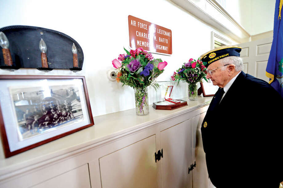 """Officials including state Rep. Gail Lavielle and the Honorary French Consul Isabelle Evelein dedicate a stretch of Route 106 in WIlton as """"Air Force Lieutenant Charles M. Baffo Memorial Highway"""" during a brief ceremony with the local American Legion Post at the Old Town Hall."""