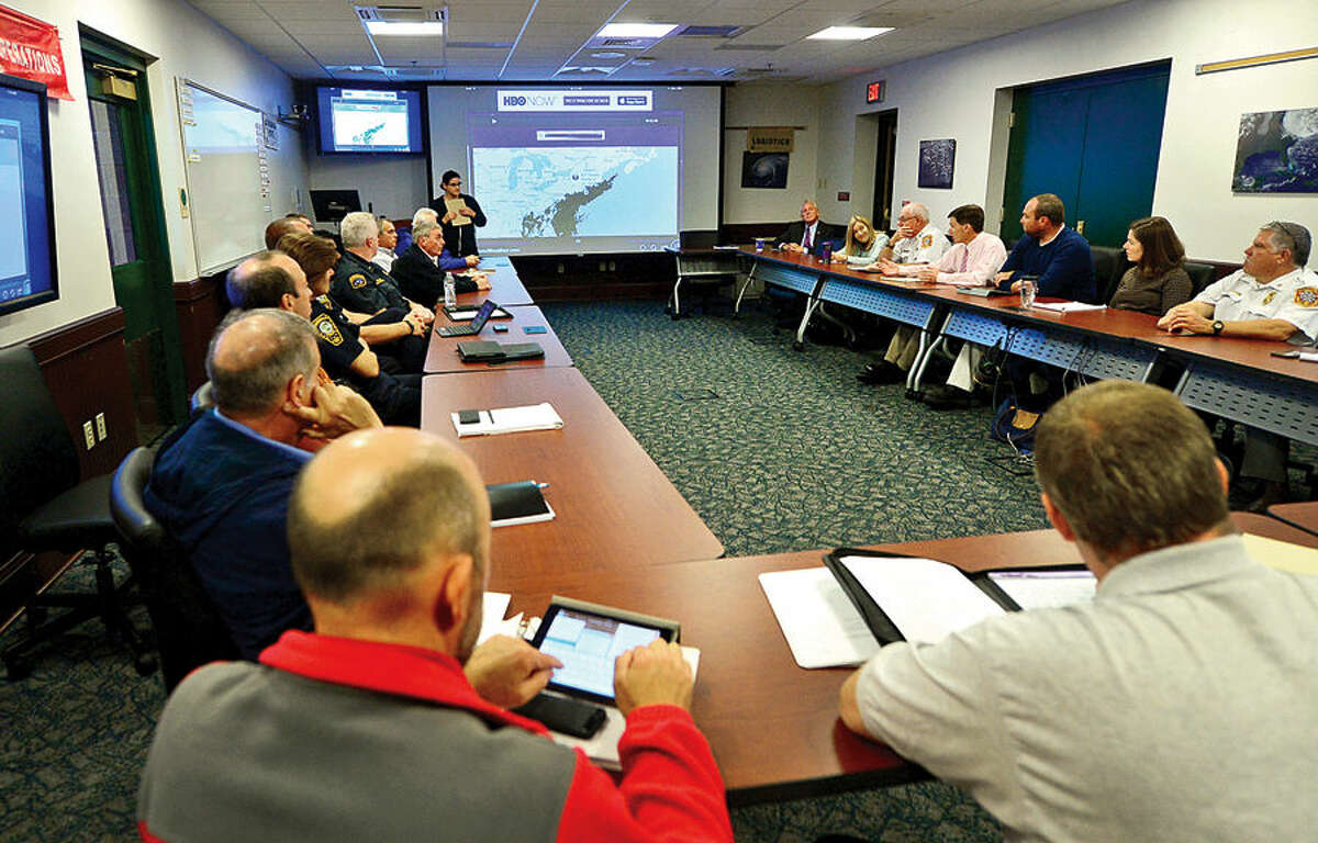 Hour photo / Erik Trautmann Norwalk's Emergency Management Team meets in the Emergency Operations Center Friday morning for an update and briefing in advance of the approach of Hurricane Joaquin.