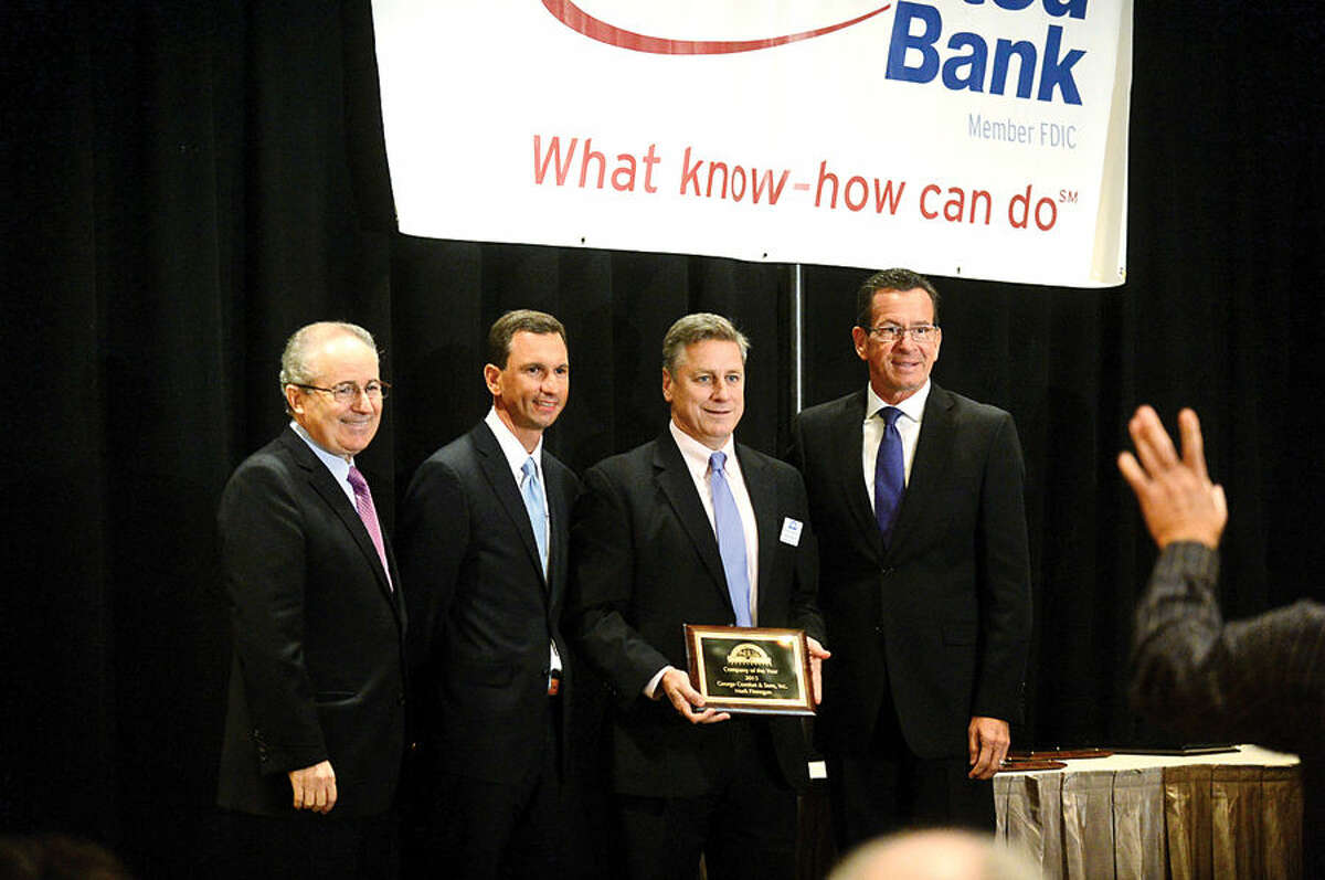 Hour photo / Erik Trautmann CT Governor Dannel Malloy helps present annual awards during the Stamford Chamber of Commerce during their lucneon at the Stamford Marriot Thursday.