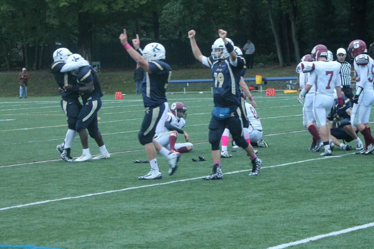 The King players celebrate after the Gunnery missed a field goal with 4.9 seconds left as King defeated Gunnery 13-12. (Hour photo/Joe Ryan)