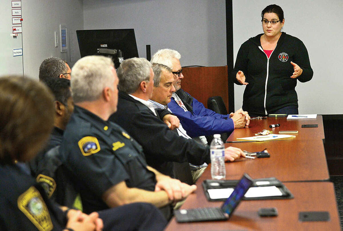 Hour photo / Erik Trautmann Michele DeLuca, Deputy Director, Norwalk Emergency Management, speaks as the Emergency Management Team meets in the Emergency Operations Center Friday morning for an update and briefing in advance of the approach of Hurricane Joaquin.