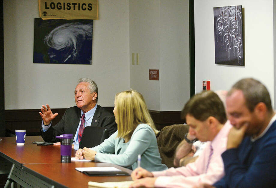 Hour photo / Erik Trautmann Mayor Harry Rilling speaks as Norwalk's Emergency Management Team meets in the Emergency Operations Center Friday morning for an update and briefing in advance of the approach of Hurricane Joaquin.
