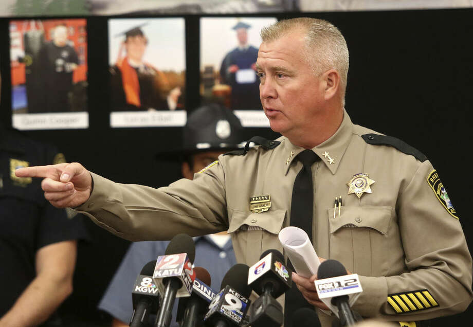 Douglas County Sheriff John Hanlin addresses the media during a news conference Friday, Oct. 2, 2015, in Roseburg, Ore, regarding the deadly shooting at at Umpqua Community College. (Michael Sullivan/The News-Review via AP) MANDATORY CREDIT