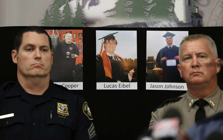 The photos of three of the victims of the mass shooting at Umpqua Community College are displayed at a news conference, Friday, Oct. 2, 2015, in Roseburg, Ore. In the photos, from left, are Quinn Cooper, 18, Lucas Eibel, 18, center, and Jason Johnson, 33. They were among those killed when Chris Harper Mercer, walked into a class at the community college, Thursday, and opened fire. At left is Portland Police Sgt. Peter Simpson and right is Douglas County Sheriff John Hanlin. (AP Photo/Rich Pedroncelli
