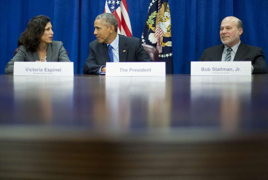 President Barack Obama talks with Victoria Espinel, CEO The Software Alliance, left, as Bob Stallman Jr. President American Farm Bureau listens at right, during a meeting with agriculture and business leaders at the Agriculture Department in Washington, Tuesday, Oct. 6, 2015 (AP Photo/Pablo Martinez Monsivais)