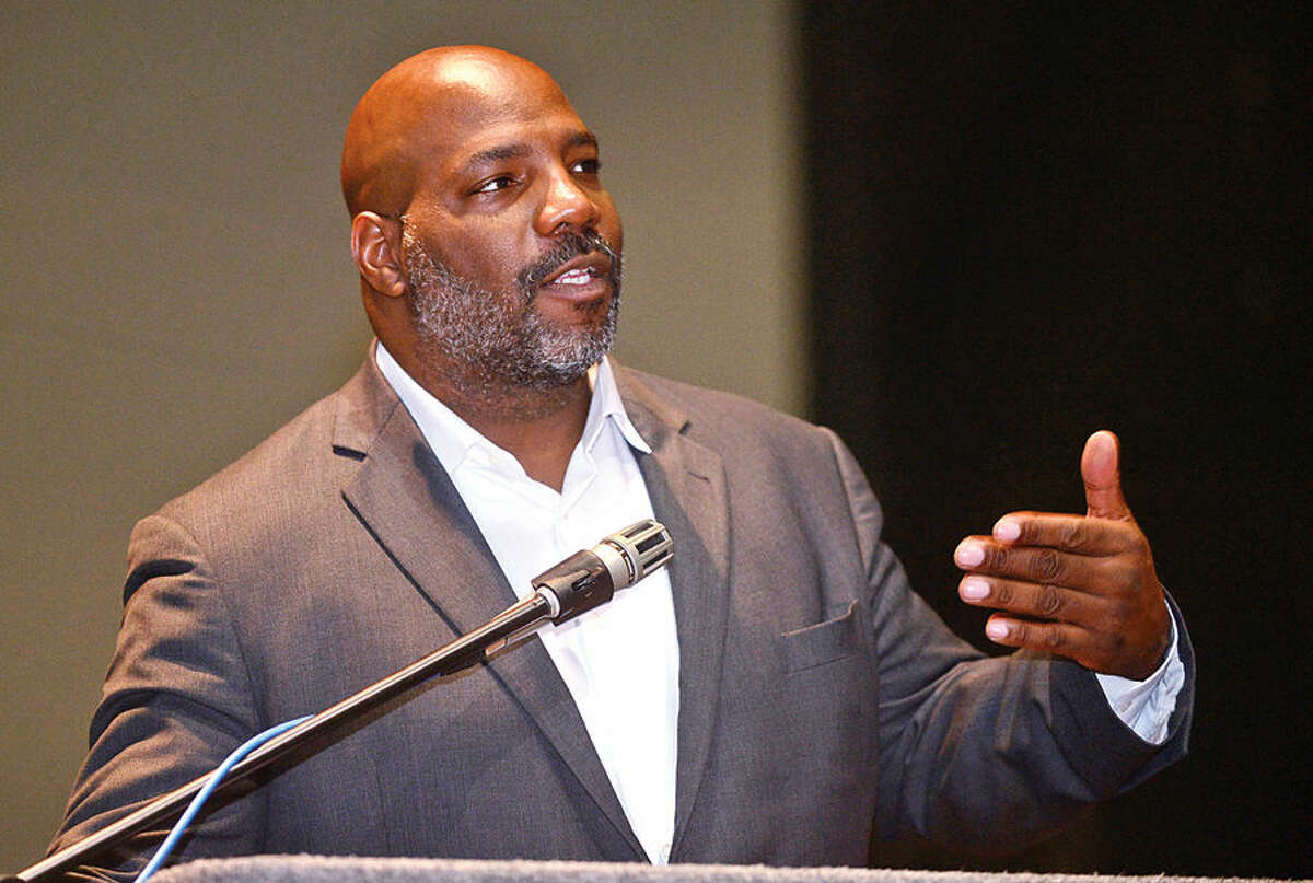 Hour photo / Erik Trautmann Staff writer for the New Yorker magazine, Associate Professor of History and Director of the Institute for African American Studies at University of Connecticut in Storrs, William Jelani Cobb, speaks at Norwalk Community CollegeTuesday afternoon.