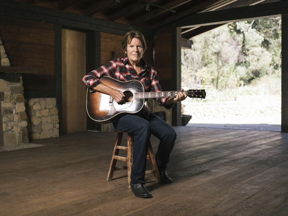 """In this Thursday, Sept. 24, 2015 photo, musician John Fogerty poses for a portrait during an interview about his new memoir """"Fortunate Son: My Life, My Music,"""" in Topanga, Calif. Although he wrote the classic Americana songbook, it took Fogerty more than 30 years to come to terms with the realization he really was one of rock music's fortunate sons. In 1969 Creedence Clearwater Revival sold more records and had more hit songs, including classics like """"Proud Mary,"""" """"Lodi,"""" """"Green River"""" and """"Bad Moon Rising,"""" than even the Beatles. (Photo by Casey Curry/Invision/AP)"""