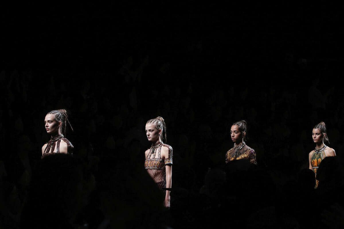 Models wear creations for Valentino's Spring-Summer 2016 ready-to-wear fashion collection, presented during the Paris Fashion Week, in Paris, France, Tuesday, Oct. 6, 2015. (AP Photo/Thibault Camus)