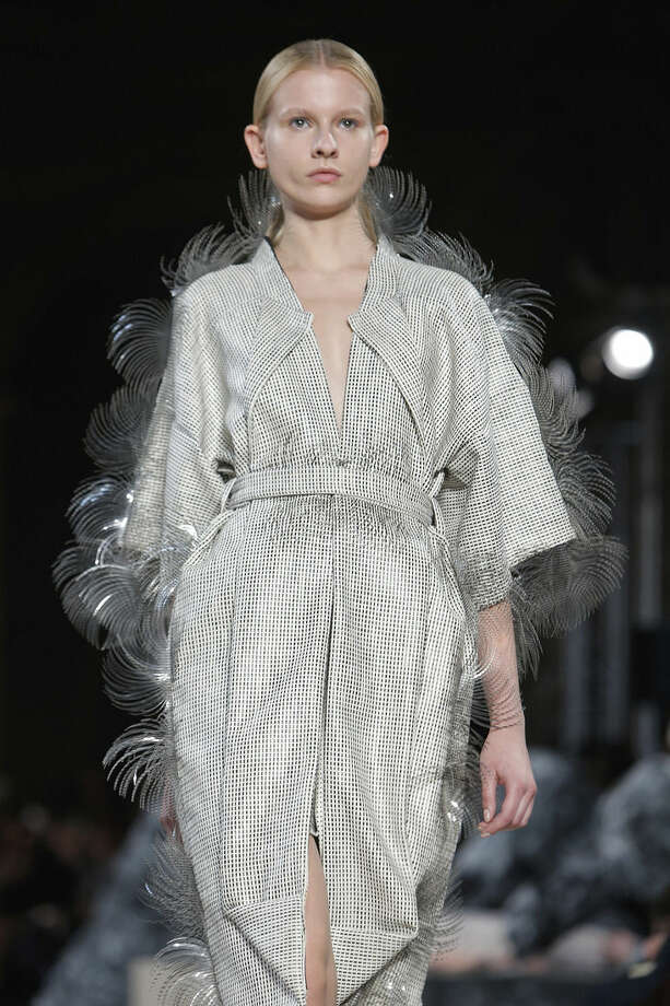 A model wears a creation for Iris Van Herpen's Spring-Summer 2016 ready-to-wear fashion collection, presented during the Paris Fashion Week, in Paris, France, Tuesday, Oct. 6, 2015. (AP Photo/Thibault Camus)