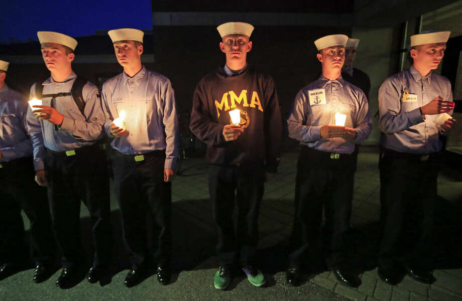 Maine Maritime Academy students attend a vigil of hope for the missing crew members of the U.S. container ship El Faro, Tuesday evening, Oct. 6, 2015, in Castine, Maine. The Coast Guard has concluded the vessel sank near the Bahamas during Hurricane Joaquin. (AP Photo/Robert F. Bukaty)