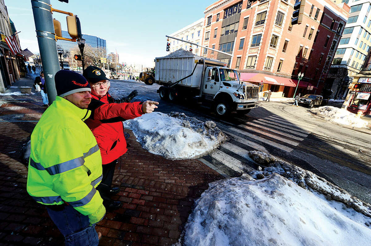 Mayor David Martin reviews Stamford's Department of Operations snow removal operations in the downtown area with Traffic and Road Maintenance Supervisor Thomas Turk.