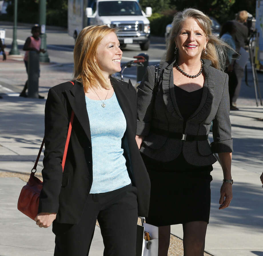 Former Virginia first lady Maureen McDonnell, right, arrives at federal court with her daughter Cailin Young, left, Friday, Aug. 29, 2014, in Richmond, Va. Closing arguments are expected to begin Friday in the McDonnell's corruption case. (AP Photo/Steve Helber)