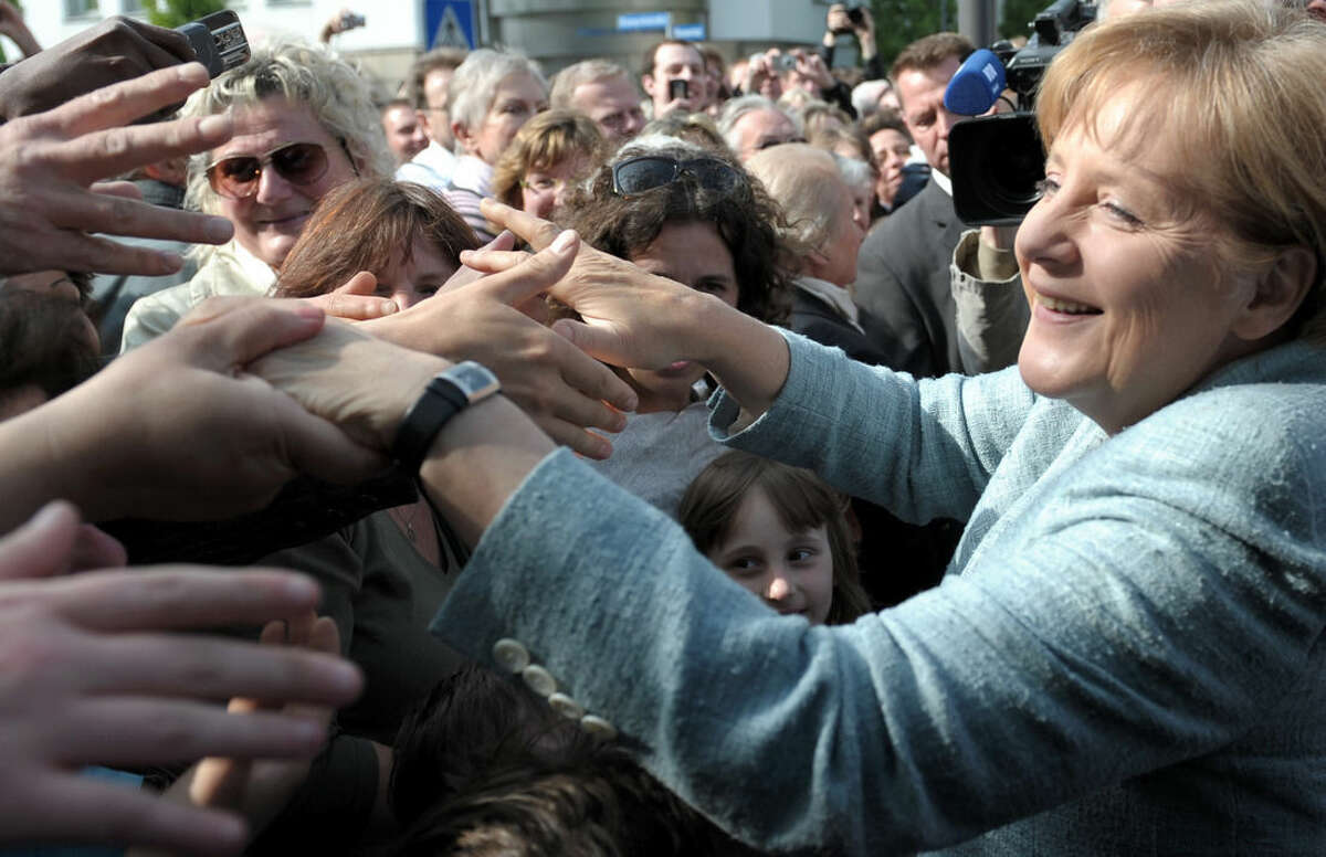 AP photo In this May 15, 2009 file photo, German chancellor Angela Merkel greets well-wishers, in Detmold, Germany.