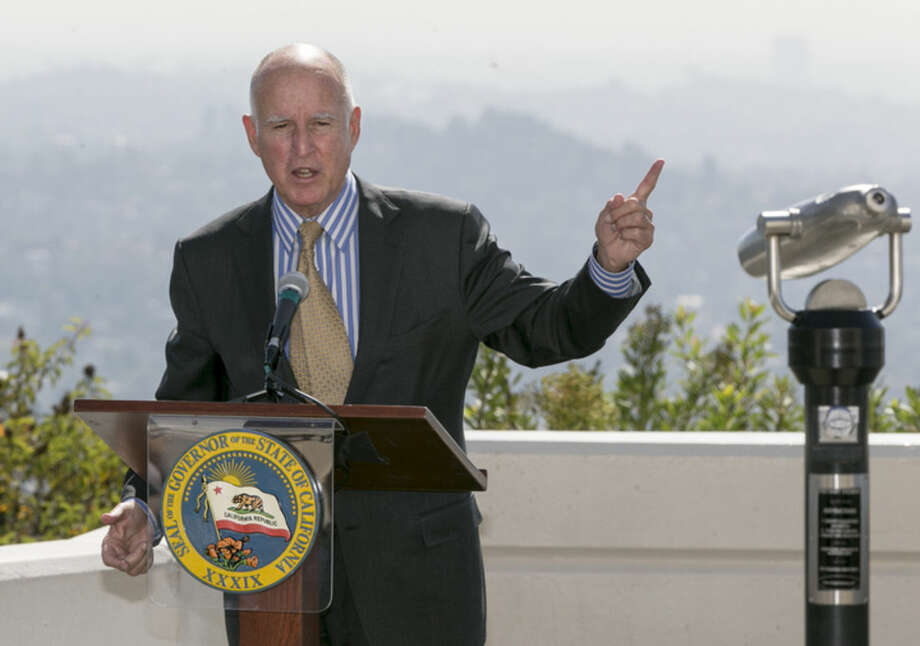 California Gov. Jerry Brown speaks before signing a bill to combat climate change by increasing the state's renewable electricity use to 50 percent and doubling energy efficiency in existing buildings by 2030 at a ceremony at the Griffith Observatory in Los Angeles on Wednesday, Oct. 7, 2015. (AP Photo/Damian Dovarganes)