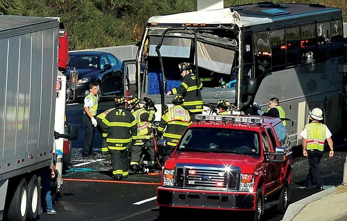 Hour photo/Erik Trautmann Coach bus collides with a tractor trailer on I-95 at exit 15 Wednesday afternoon trapping the bus driver.