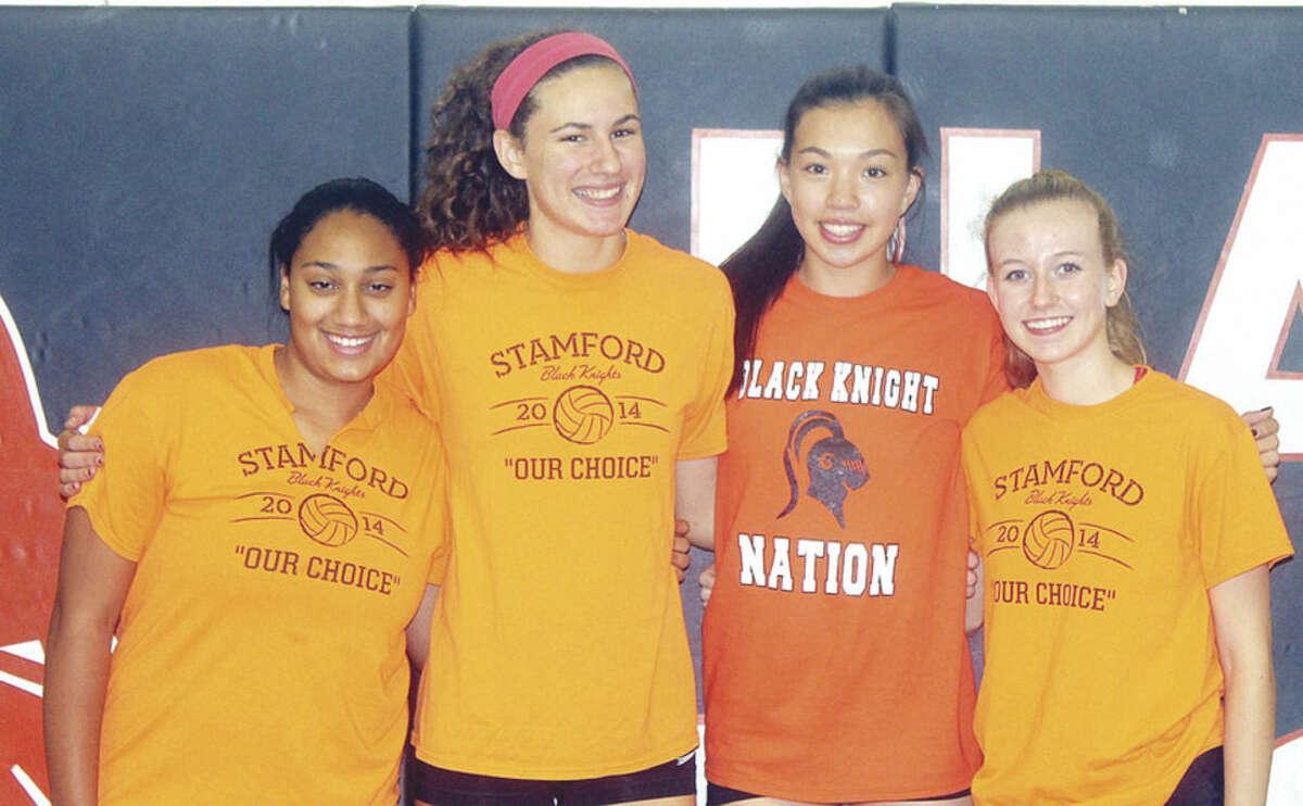 Photo by Joe Ryan Stamford High volleyball players, from left, Jayla Wilson, Andrea O'Connor, Sara Staley, Lisa Balazs were key cogs in the Knights win over Trinity Catholic last week.