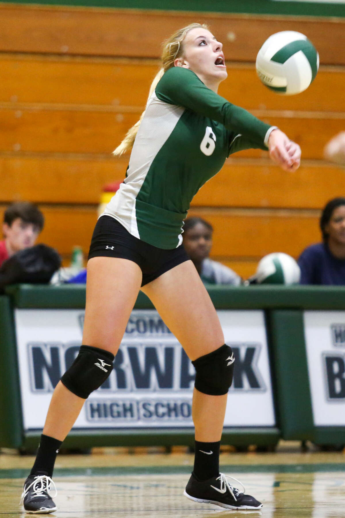 Hour photo/Chris Palermo. Amanda Beckwith volleys the ball against New Canaan Wednesday evening at Norwalk High School.