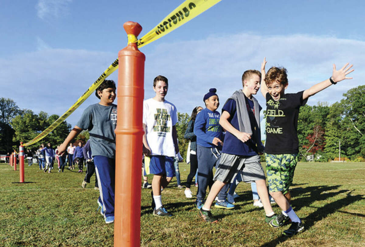 Hour photo/Erik Trautmann Ponus Ridge Middle School 7th-grader Bobby Fosina, right, and his classmates participate in the school's annual Walk-A-Thon Wednesday to benefit school programming.