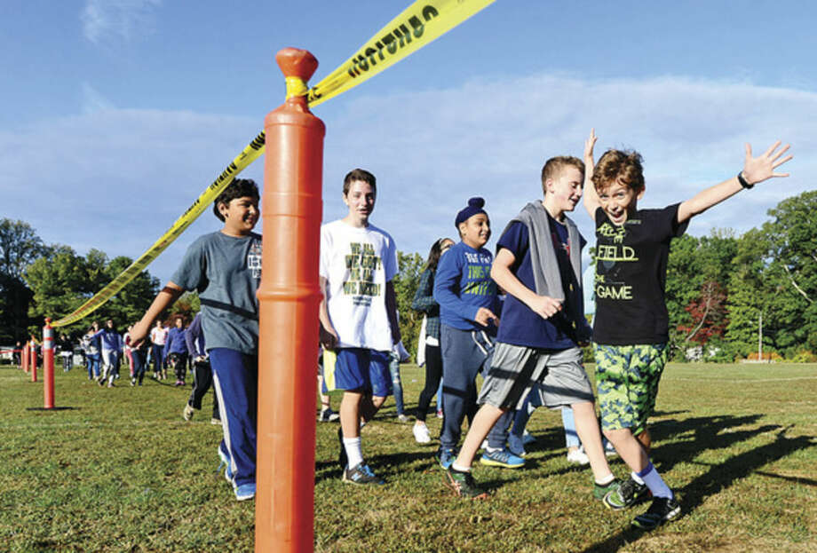 Hour photo/Erik TrautmannPonus Ridge Middle School 7th-grader Bobby Fosina, right, and his classmates participate in the school's annual Walk-A-Thon Wednesday to benefit school programming.