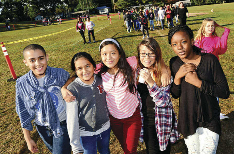 Hour photo/Erik TrautmannPonus Ridge Middle School 7th-graders, from left, Javon Grant, Amy Chacon, Scarlett Cordero, Darice Alvarado and Crystal Pierre, participate in the school's annual Walk-A-Thon Wednesday.