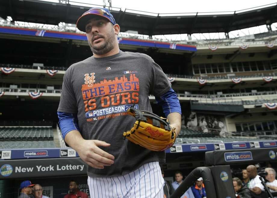 New York Mets' pitcher Matt Harvey runs out onto the field before a workout at Citi Field, Wednesday, Oct. 7, 2015 in New York. The Mets will play the Los Angeles Dodgers in a National League Division Series starting Friday in Los Angeles. (AP Photo/Seth Wenig)
