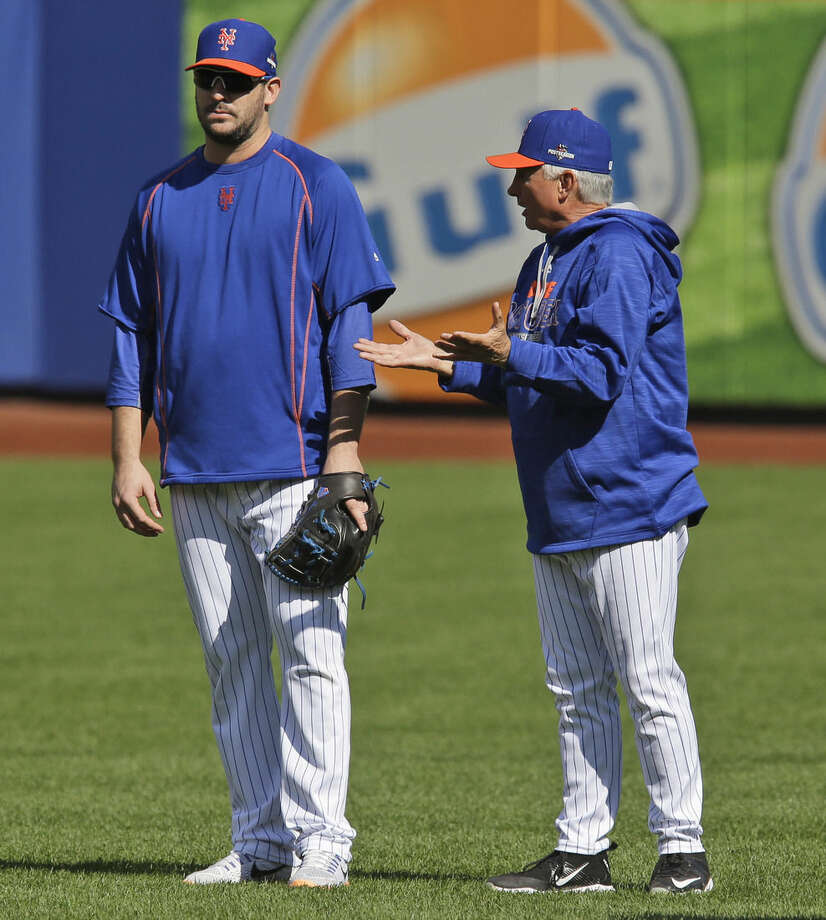 New York Mets manager Terry Collins, right, talks with pitcher Matt Harvey during a workout at Citi Field, Wednesday, Oct. 7, 2015 in New York. The Mets will play the Los Angeles Dodgers in a National League Division Series starting Friday in Los Angeles.. (AP Photo/Seth Wenig)