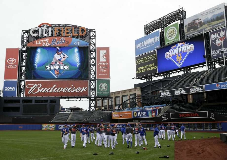 New York Mets warm up during a workout at Citi Field, Wednesday, Oct. 7, 2015 in New York. The Mets will play the Los Angeles Dodgers in a National League Division Series starting Friday in Los Angeles. (AP Photo/Seth Wenig)
